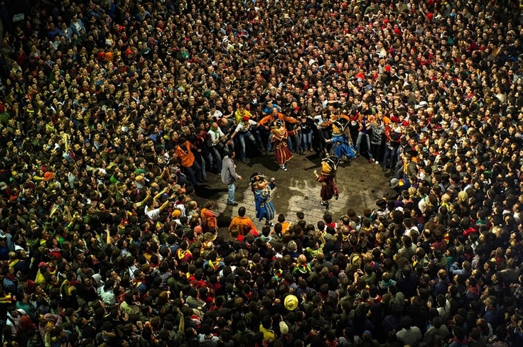 Revelers surround the Nans Vells - old dwarves in Catalan - during the first day of the Patum festival in Berga, Catalonia, Spain, on May 30, 2013.