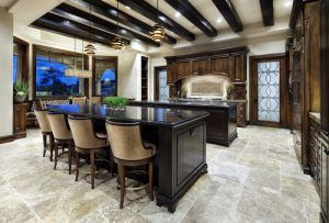 A big sized mediterranean styled kitchen with large windows.