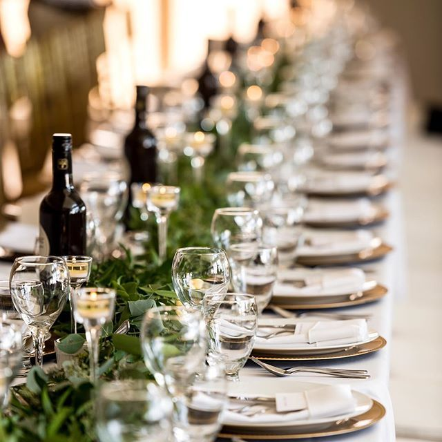 I just love the long family table set up for wedding receptions. It feels so much more intimate than having individuals tables. Of course it works beautifully for large families who love being together :).