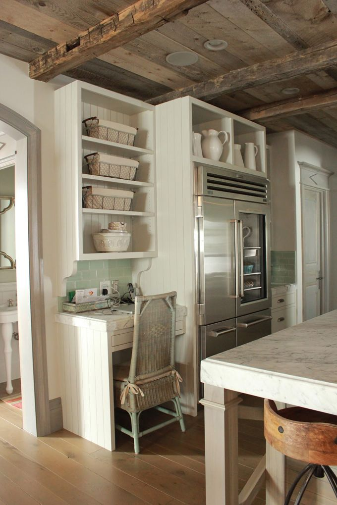 could do something like this on hallway wall where they have a large hutch now. Built in fridge, and could do floor to ceiling pantry instead of desk. via:House of Turquoise: Kitchen