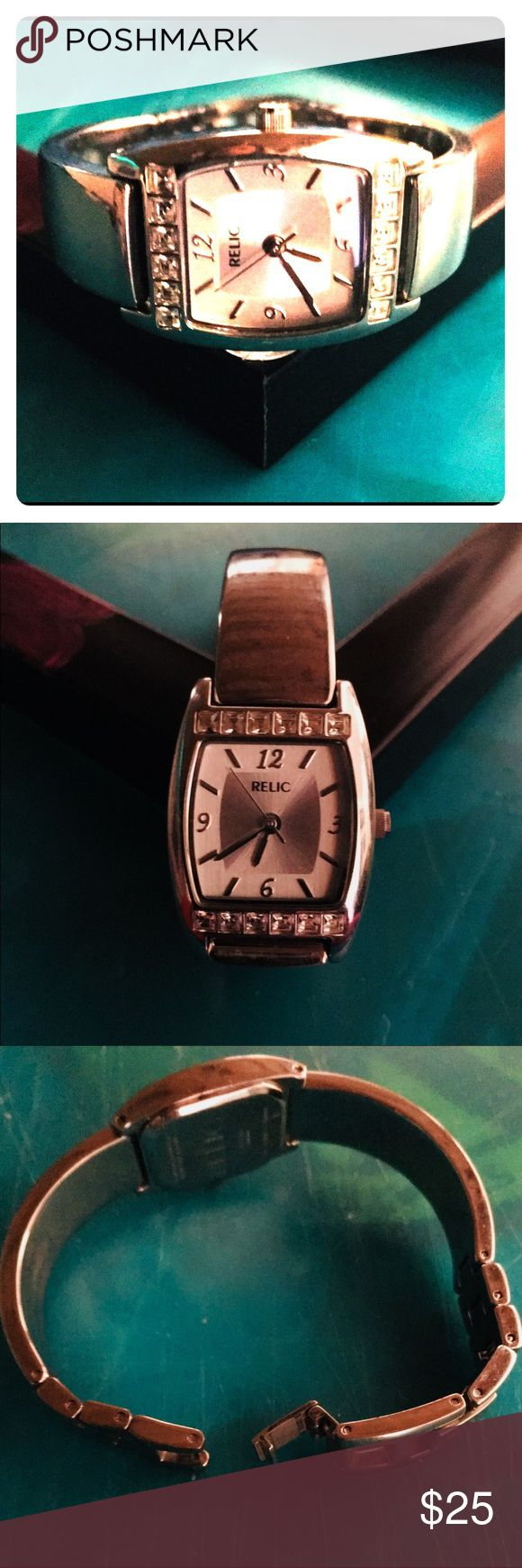 Ladies Relic Watch Beautiful shiny silver. Rarely worn. My wrists are smaller so it's fitted for a more petite wrist. Has diamond like studs  on the top and bottom of the face. No scratches. Works perfect and is pretty on the wrist. Accessories Watches