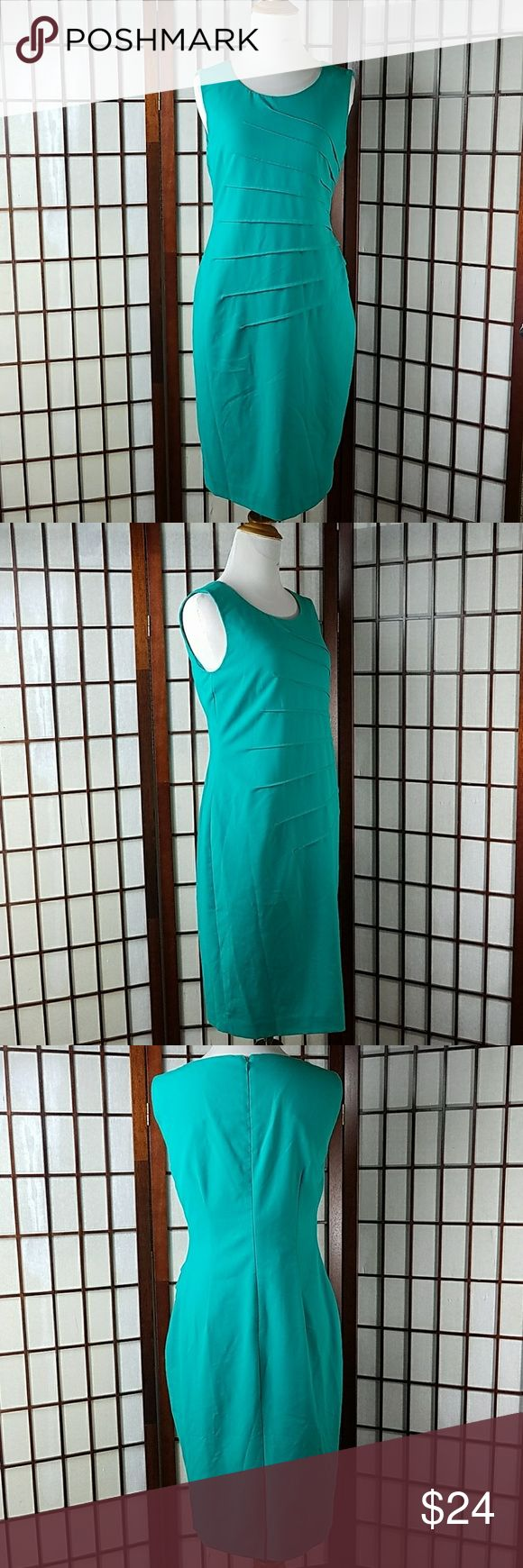 "Calvin Klein Sheath Dress Size 6 Pre-owned gently worn  CALVIN KLEIN SIZE 6 Sheath Dress style  Sleeveless sleeve style Pleated Front  Solid pattern Shade of Green  (shamrock green) color Lined Made of polyester,  rayon and spandex   Measurement Approximate  Pit to pit 16.5"" Shoulder to hem 38"" Waist 30"" Calvin Klein Dresses"