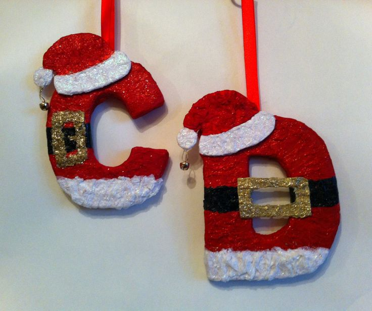 Personalised Santa letters made from cardboard , tissue paper, glue  ribbon. www.giftsnbits.com