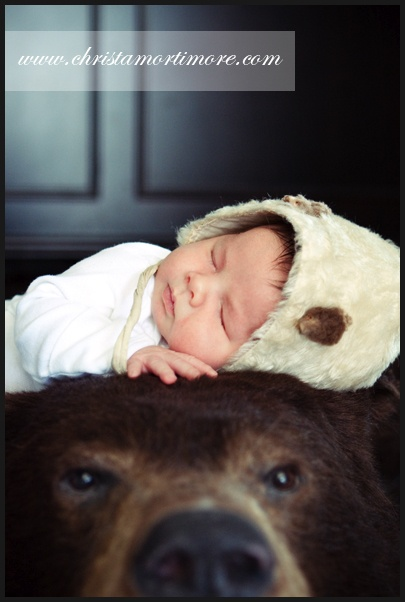 newborn on bear skin sort of like this - Bearskin Rug
