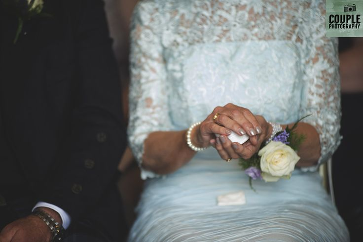 Mother of the groom holding the wedding rings during a 'ring warming ceremony'. Weddings at Tulfarris Hotel & Golf Resort photographed by Couple Photography.