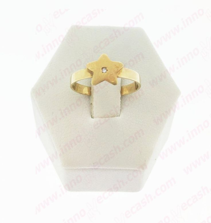 Anillo de oro de 18 quilates de segunda mano con forma de estrella. http://www.innovecash.com/joyeria/anillo-de-oro-de-18-quilates-de-segunda-mano-forma-estrella-534.html