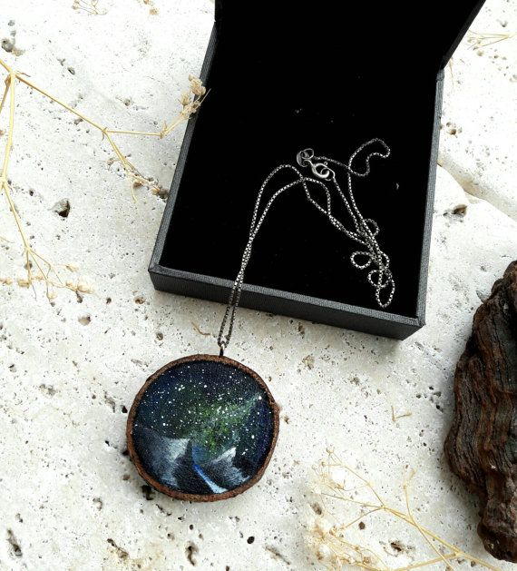 Pendant representing mountains landscape in a starry night  Painting on wood slice   #pendant #starrynight #painting #handmade
