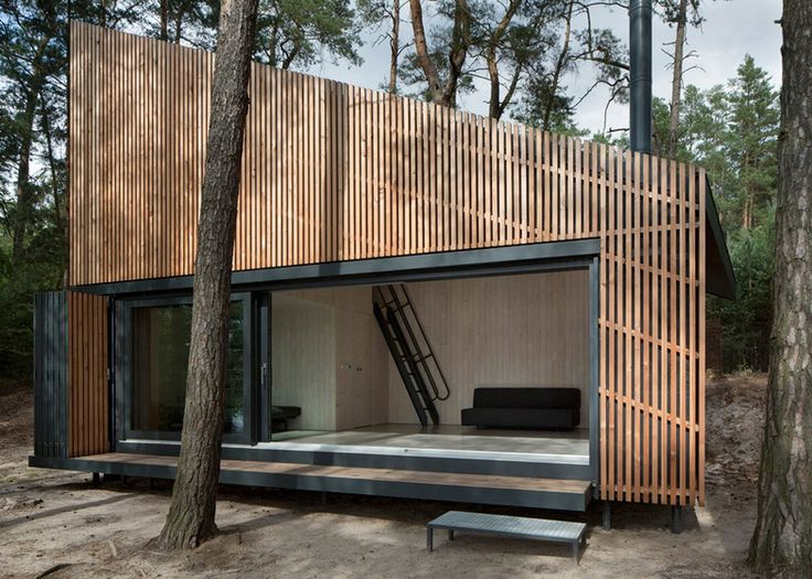 This wedge-shaped cabin in the Czech Republic has a folding screen set into one…