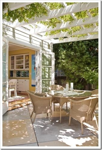 Love this; pergola with greenery over the patio and open French doors. My goals eventually for the back of our house.