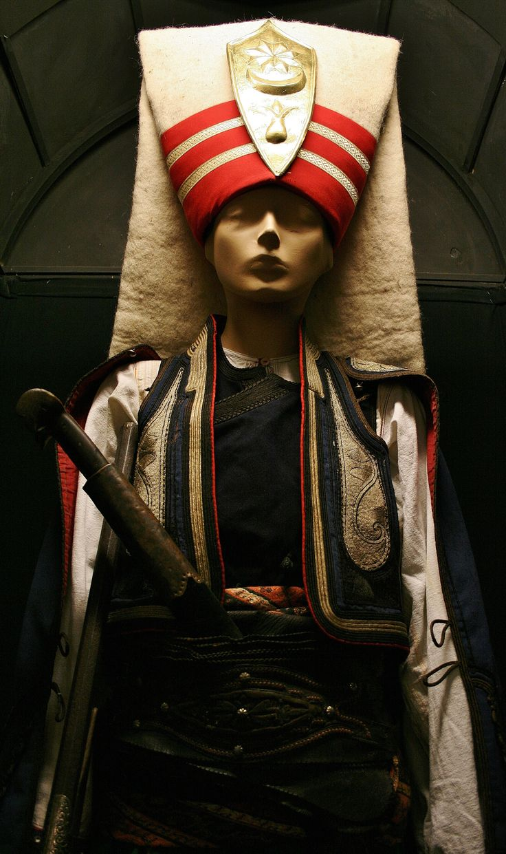 A 'Yeniçeri' (low rank Janissary soldier) in uniform. Late-Ottoman, c. 1810. The large flap of the headdress was in imitation of the sleeve of Hacı Bektaş, founder of the Bektaşi dervishes, who laid his hand on early Janissaries to give his blessing. Later on, the Bektaşi Order supplied the Janissary Corps with 'babalar' (spiritual leaders).