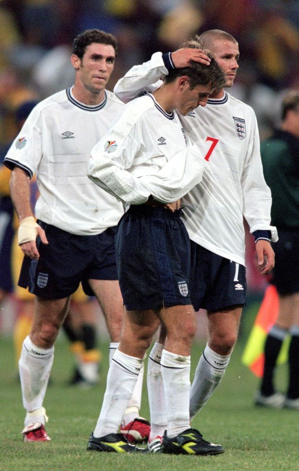 Over and out: Phil Neville (centre) is consoled by Martin Keown (left) and David Beckham (right) after he conceded the penalty that knocked England out of Euro 2000