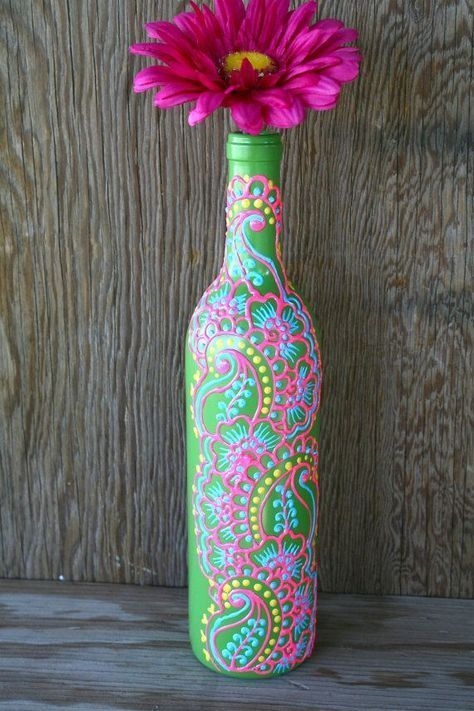 Hand-painted And Recycled Wine Bottle - turn an old wine or liquor bottle into an elegant vase! Start by painting the bottle pastel aqua then add paisleys and dotted detailed designs with puff paint or acrylics. So pretty! Super creative upcycle project! #recycledwinebottles
