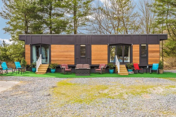 The 420 sq.ft. park model Dreamwood was created by Humble Houses in Germantown, MD. The luxurious single-level tiny house features a sleek, modern exterior.