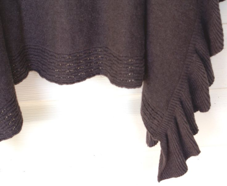 A personal favorite from my Etsy shop https://www.etsy.com/listing/227823003/alfani-angora-mink-colored-sweater-cape