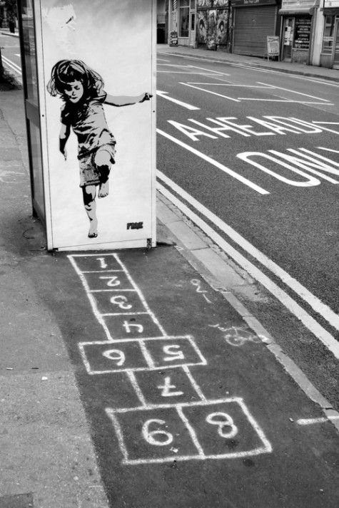 How many of us have not played this game as children ? Now take that memory give it to Banksy and what you get is street art in its best form.