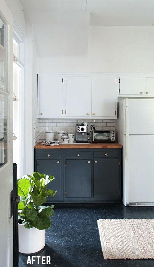 Painted Black kitchen floor cabinets with white wall cabinets.  Via Manhattan Nest   Kitchen