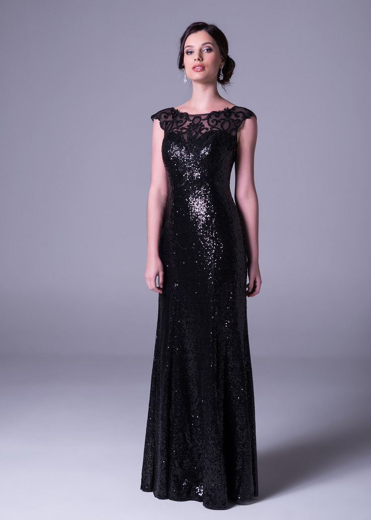A classic #blackdress never goes out of style - but who wants to look ordinary? We love this black #eveninggown from our #newcollection - #sequins and sheer #lace embellished neckline complete the stylish look.   Click to book a free fitting in this dress, or view more online form Bride&co #southafrica stores. #blackdresses #dresses