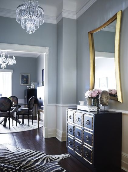 Love this: the mirror's gilt frame draws out the gold trim and metal drawer pulls of the Dorothy Draper chest in this entryway.