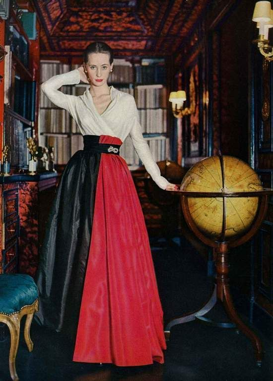 Christian Dior 'Grand Guignol' gown featured in US Vogue May 1951. A soft shirt of silk organdie with a slash of red panels over the black taffeta skirt. Photographed by John Rawlings in the Paris house of Mme.Robert Lazard.
