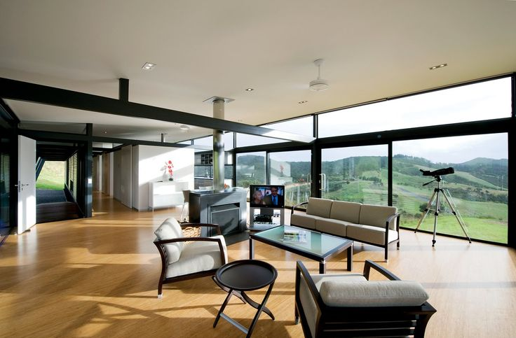 The emblematic Mann house in Bay of Island, New Zealand, full of STUA furniture.