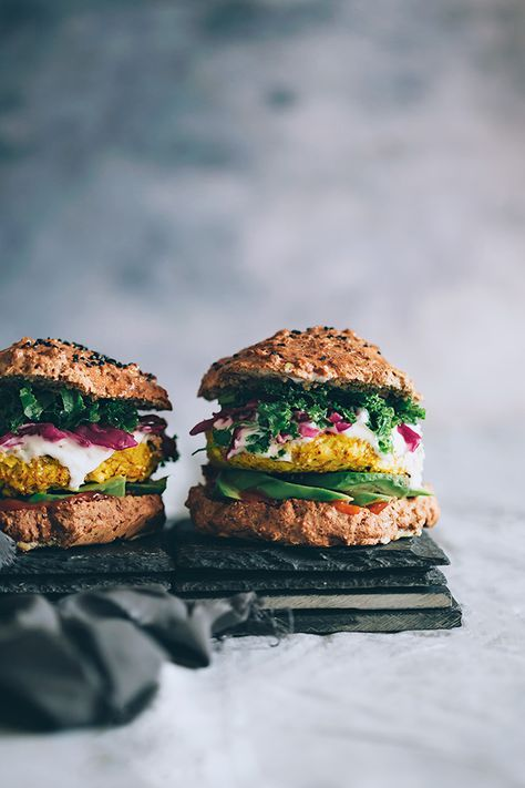 Spiced cauliflower burger with sauerkraut, avocado and kale   http://TheAwesomeGreen.com