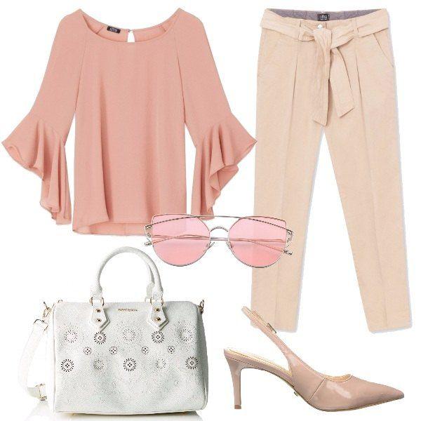 L'outfit è composto da una blusa color rosa con maniche a campana ed un paio di pantaloni beige con piega stirata sulla gamba e fusciacca in vita. Il look si completa degli occhiali da sole con lenti colorate, una borsa bianca a bauletto Desigual ed un paio di scarpe Chanel in pelle.