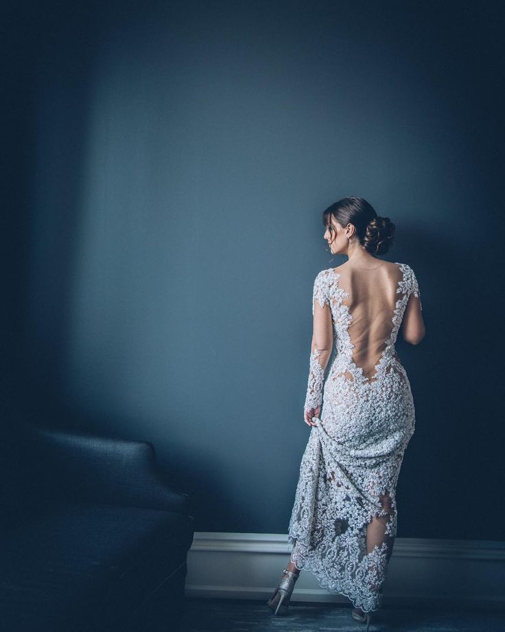 Jaw dropper bridal gown with a sheer back and stunning lace detail. #bridalgown #weddingdress #sheerback #lowback #designerweddingdress