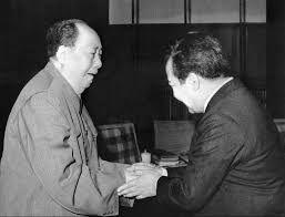 Mao (L) greets Sihanouk at Peking, August 28, 1975.