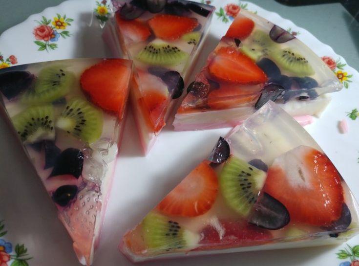 """Jelly Fruit Halwa is a fantastic recipe. It is a light, refreshing and a beautiful """"fruitcake"""" with colourful fruits embedded in the jelly. I have used strawberries, kiwi and black grapes. You can also use Mango, Pineapple, Litchi, etc. This dessert is so good to eat along with the fruits in between jelly."""