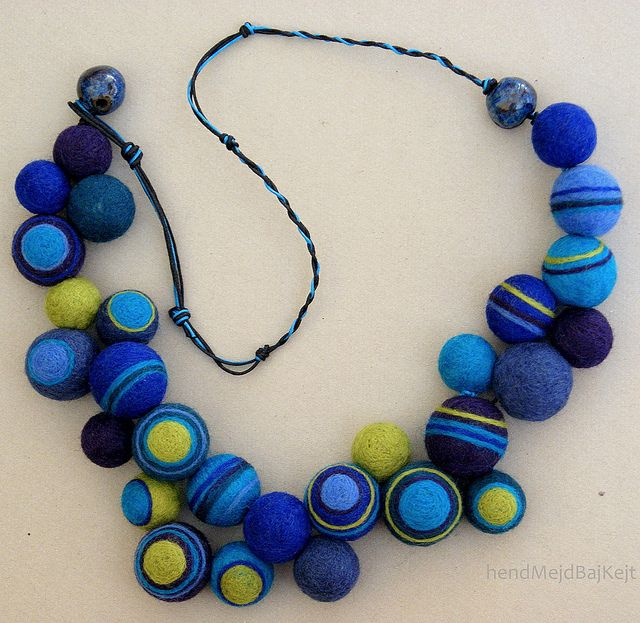 I am in love with this necklace!  I'd never have the patience to make that many felt beads, though...