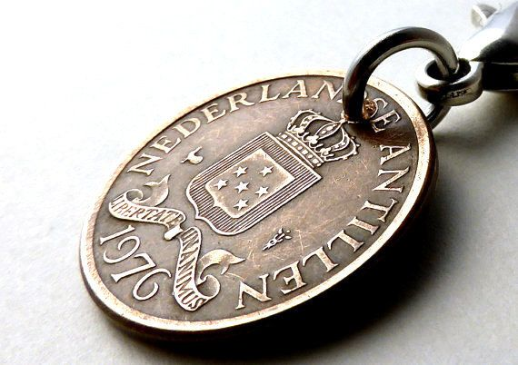 Hey, I found this really awesome Etsy listing at https://www.etsy.com/listing/228647055/dutch-antilles-coin-charm-caribbean