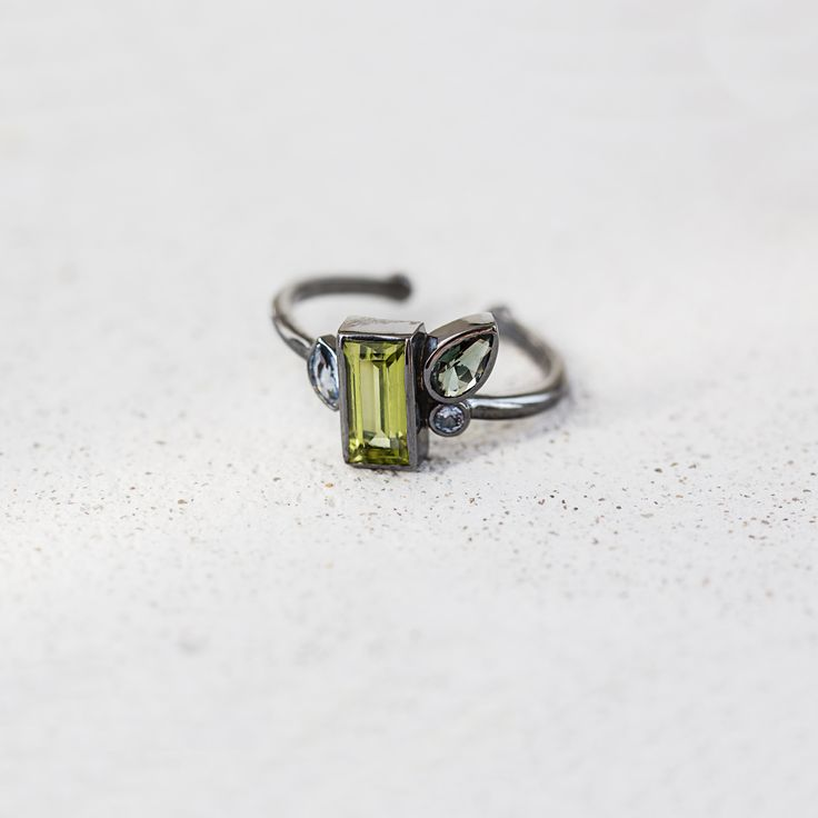 Silver cluster ring with chrysolite by ResDepot