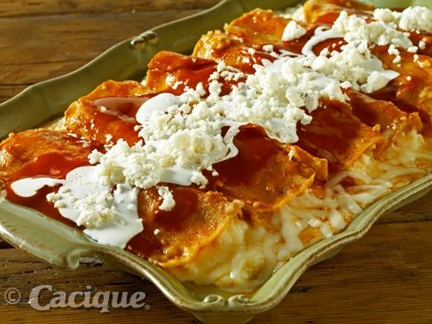 In this Enchilada recipe you will need manchego, queso fresco, crema mexicana, corn tortillas and red enchilada sauce.
