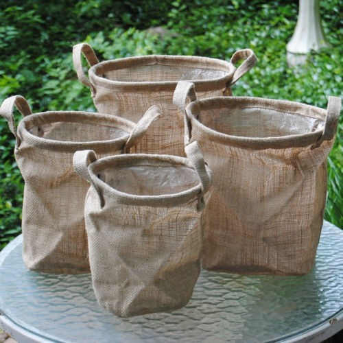 Burlap baskets to hold flip flops for the dance floor and shawls for the cold ladies.