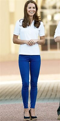 The Duchess of Cambridge wore cobalt skinny jeans, a polo shirt and cork wedges at the Olympic torch relay at Buckingham Palace.