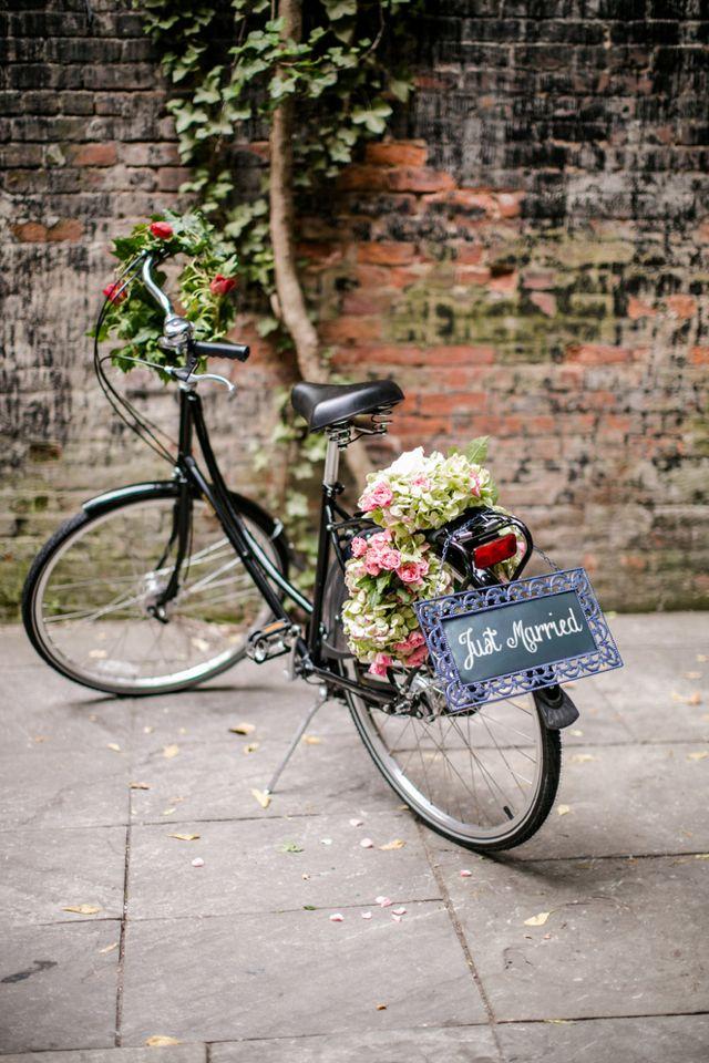 Flower adorned 'getaway' bike   Petronella Photography   see more on http://burnettsboards.com/2014/02/brooklyn-wedding-inspiration-vintage-details/