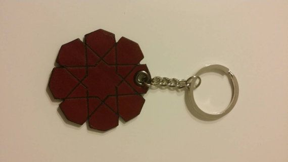 Check out this item in my Etsy shop https://www.etsy.com/listing/220433994/leather-keychain-geometric-star