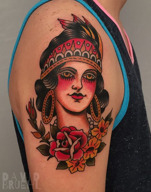Classic traditional tattoo of a gypsy woman with flowers on an arm. By David Bruehl at RedLetter1 in Tampa, Florida.