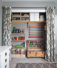 "I like the idea of curtains in place of doors. The chest with ribbon spools and tubs to store small/medium items has rollers so if you are undergoing a big project, you can have it right next to the table  roll back into place when done."" data-componentType=""MODAL_PIN"