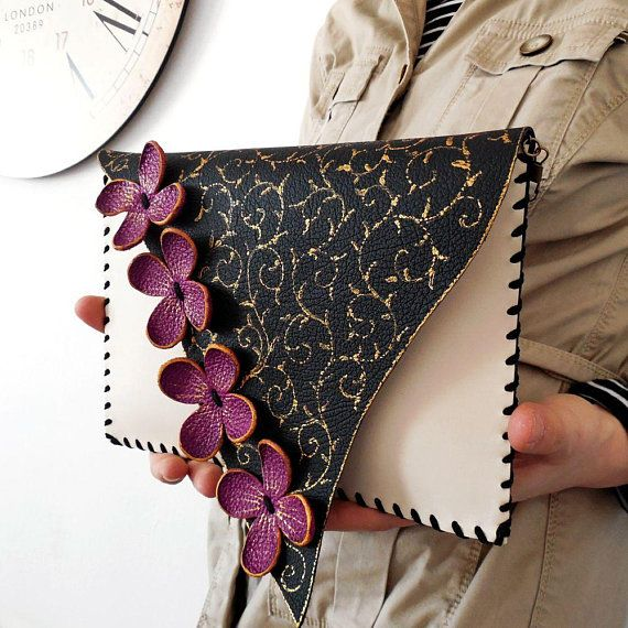 This unique design floral leather clutch with daisies and wheat ver …