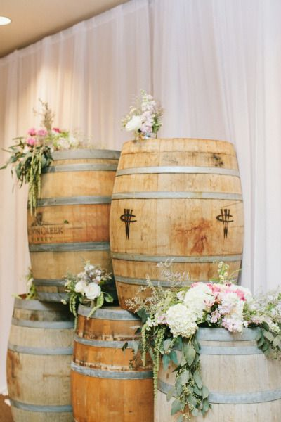 Barrels and blooms make for gorgeous rustic decor: http://www.stylemepretty.com/little-black-book-blog/2014/09/11/romantic-wilson-creek-winery-wedding/ | Photography: Wai Reyes - http://waiphoto.com/