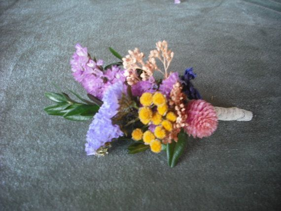 Boutonneire made with colorful dried flowers and herbs. For your groom, bestman and ushers.