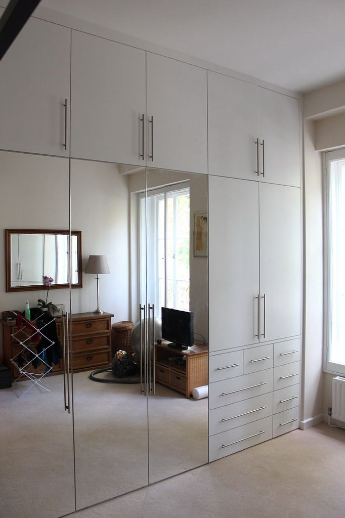 This carpentry company has photos of the kind of mirrored doors/white mixture…