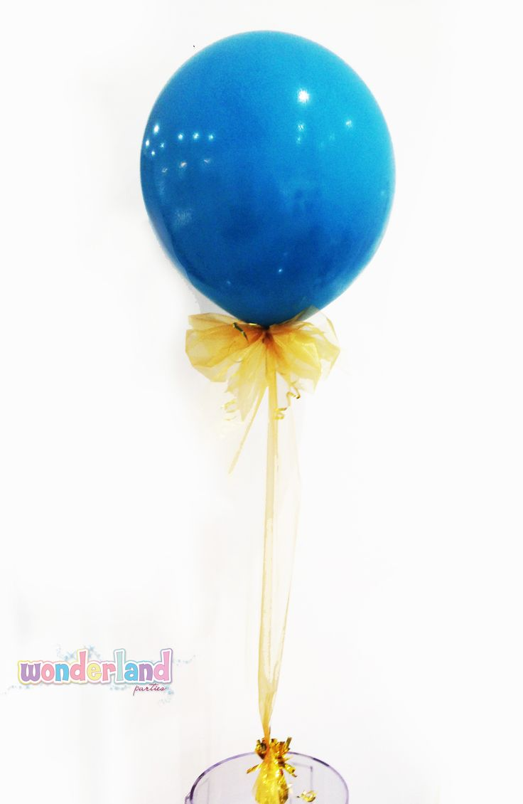 Balloon decorated with gold ribbon -http://www.wonderlandparties.com.au/