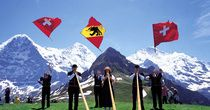 Trips, excursion tips, trip destinations - Switzerland Tourism. Flag throwing Grindelwald.