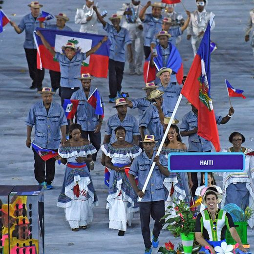 Haiti's flagbearer Asnage Castelly leads his delegation during the opening ceremony of the Rio 2016 Olympic Games at the…