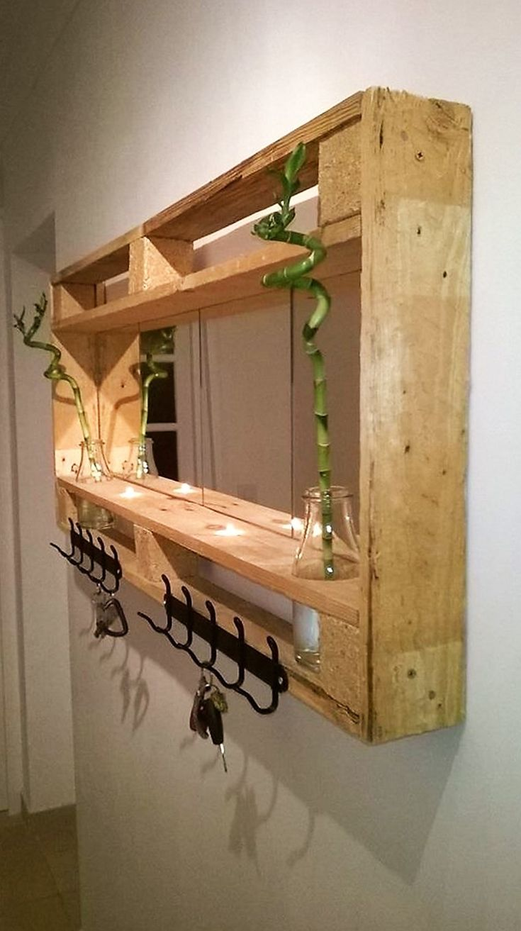 Everyone wishes to decorate their home in an innovative manner. A pallet wood made shelf with a separate shelf to hold plants and a key holder is a great idea.