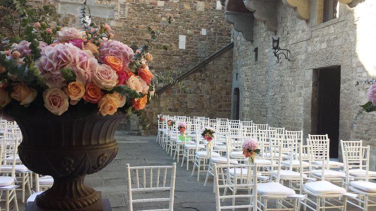 coral wedding ceremony florals urns on pillars