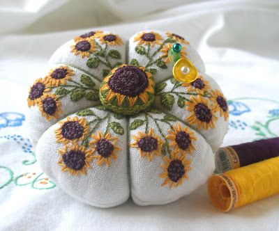A finished sunflower pin cushion from... http://fiberluscious.blogspot.com.au/p/blocking-your-embroidery.html