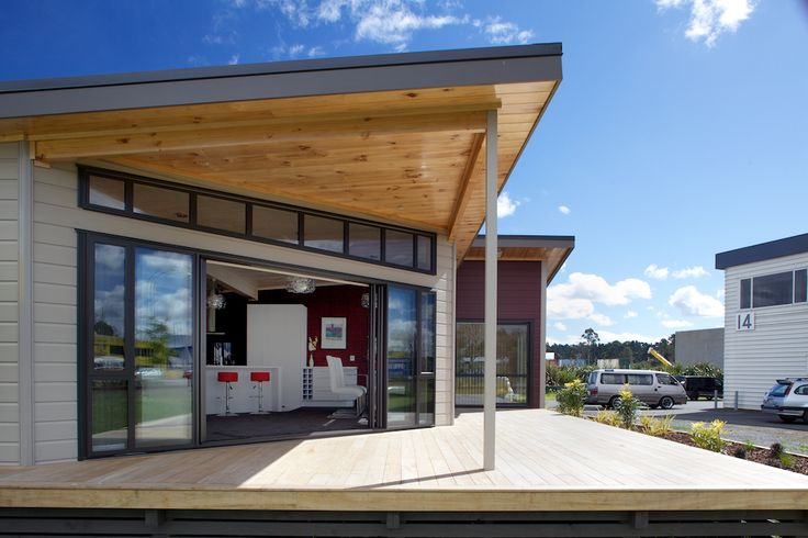Lockwood Kaipara show home with high clerestory windows and sliding stacker doors to open the living and dining areas onto the decks